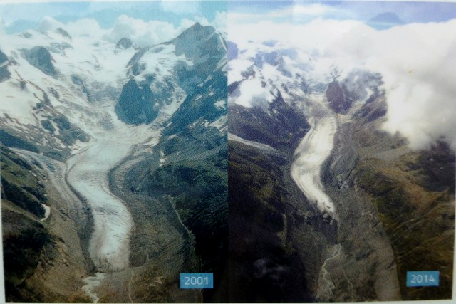 Posters show how far the glacier recedes