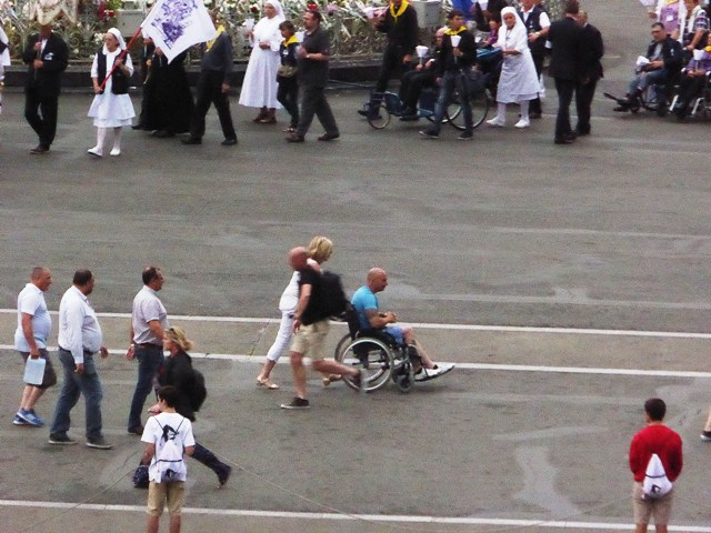 Just who is that in the wheelchair?????