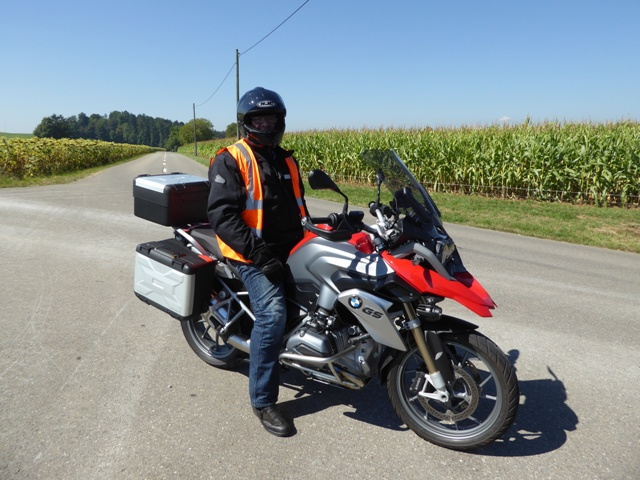 "John H rides as ""back-marker"""