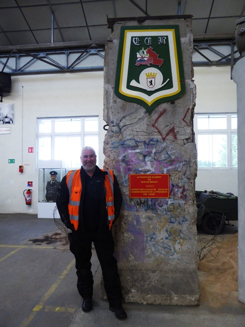Mike by a genuine piece of the Berlin Wall