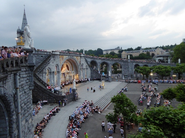 See the nightly procession in Lourdes