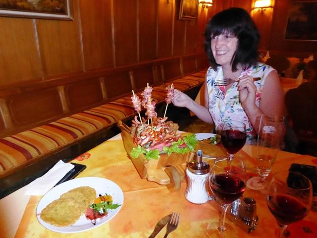 Denise & John share a wheelbarrow of food!