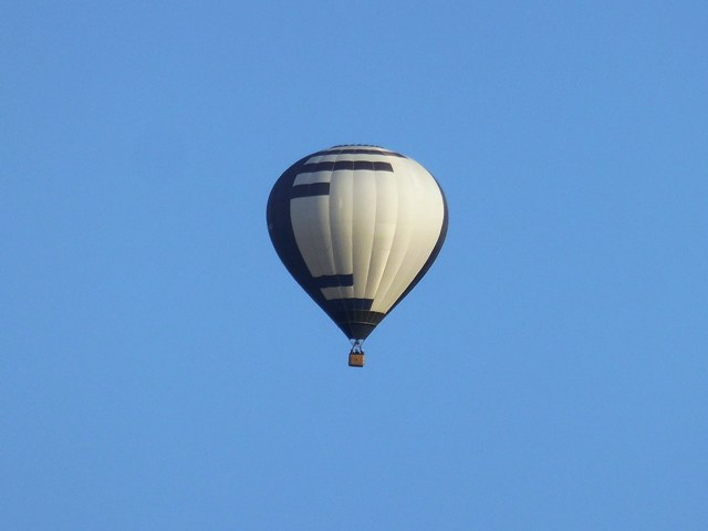 Hot air balloon passes overhead