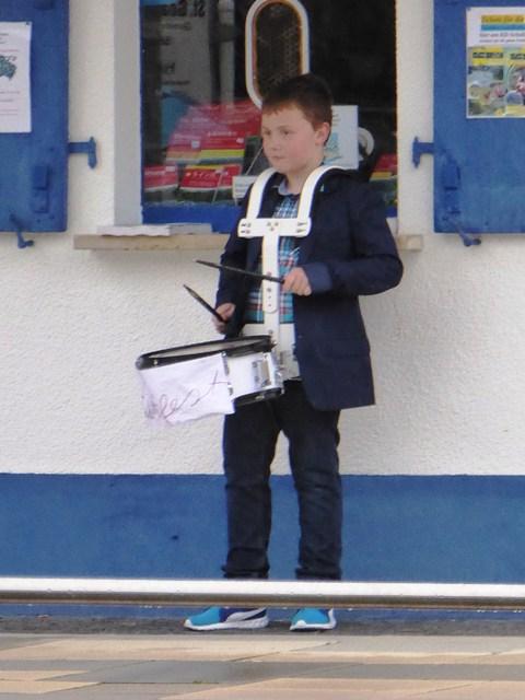 Drummer boy greets disembarking passengers