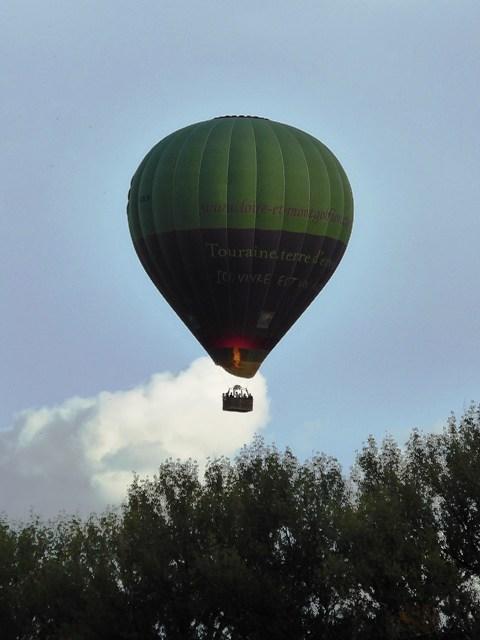 Hot air balloons pass overhead