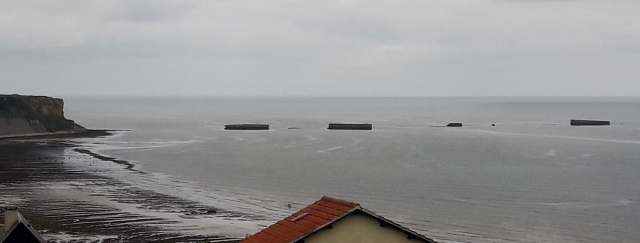 See the remains of the Mulberry B floating harbour at Arromanches