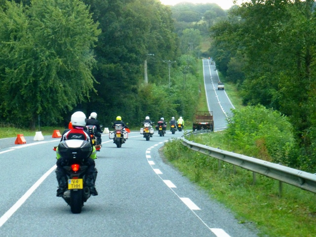 The bikes stuck behind a tractor