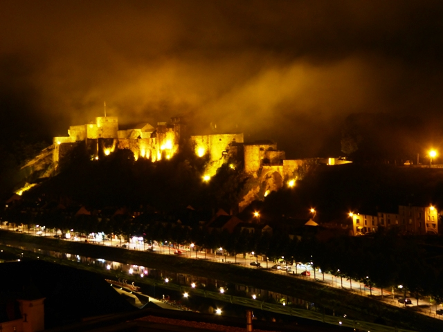 The castle lit up at night