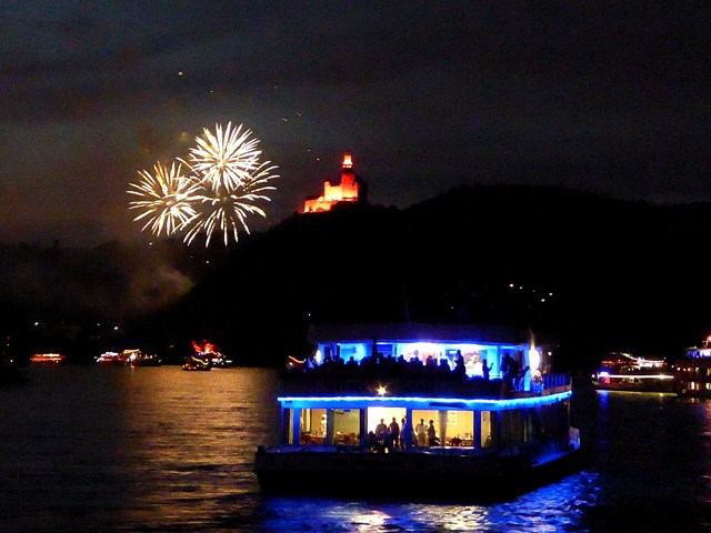 The fireworks start along the river