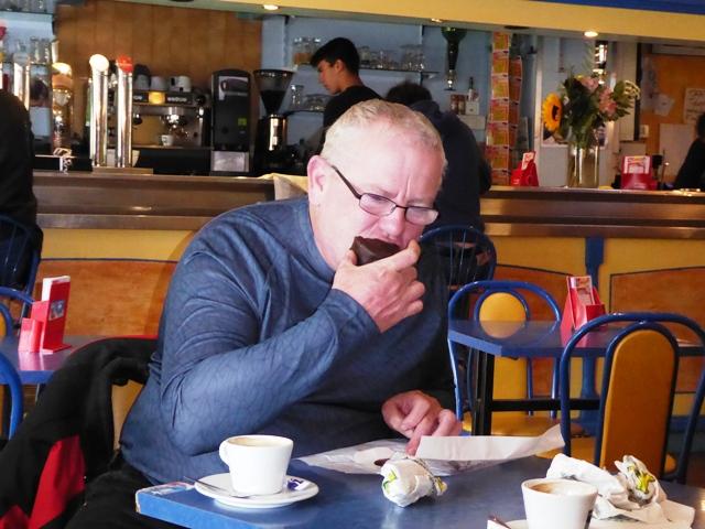 Andy devours a cream cake !