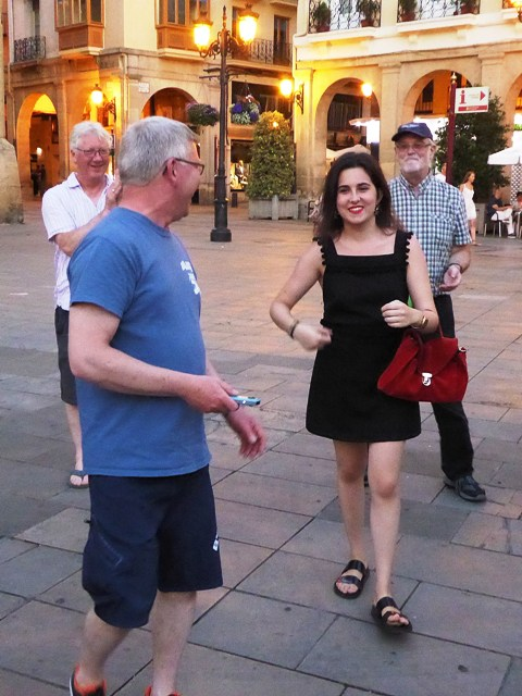 Phil approaches a young lady under a lamppost...
