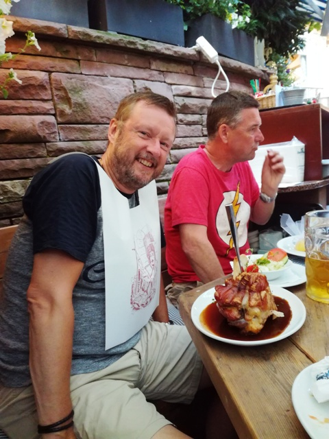 John Y with a huge knuckle of pork! (Thanks John S for the photo)