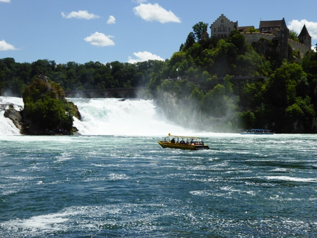 Some take a boat out to the falls