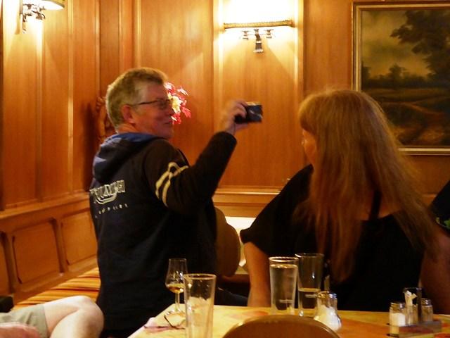Tony demonstrates Jen taking photos
