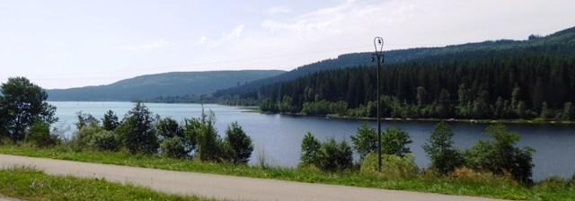 We ride alongside the lake