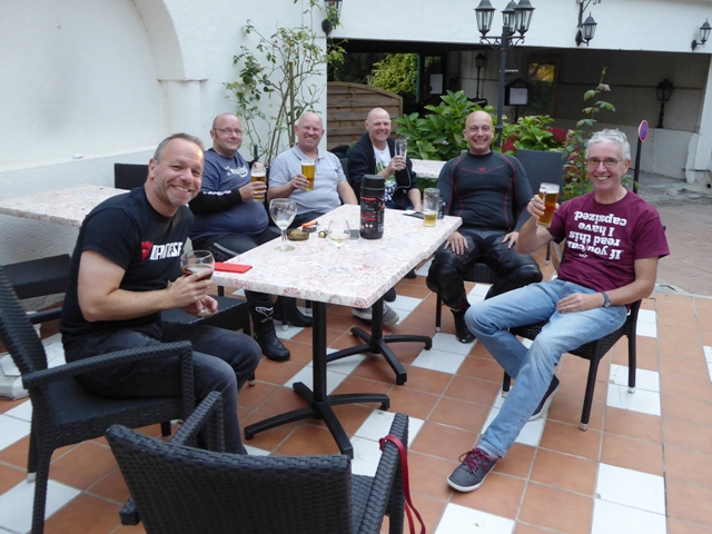 Others enjoy a drink on the terrace
